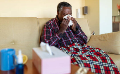 old man coughs due to pneumonia infection